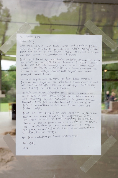 A letter to the curator displayed on the gallery window.